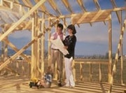 Couple with child inside house framing