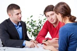Mortgage broker meeting with couple