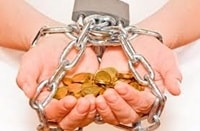 Hands chained together holding gold coins