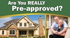 Couple embracing in front of house with the message, are you really pre approved