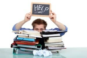 mortgage brokers - Stressed out business man holding up message on small blackboard asking for help