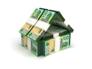 first home buyer loans - House shape made out of wads of $100 dollar bills