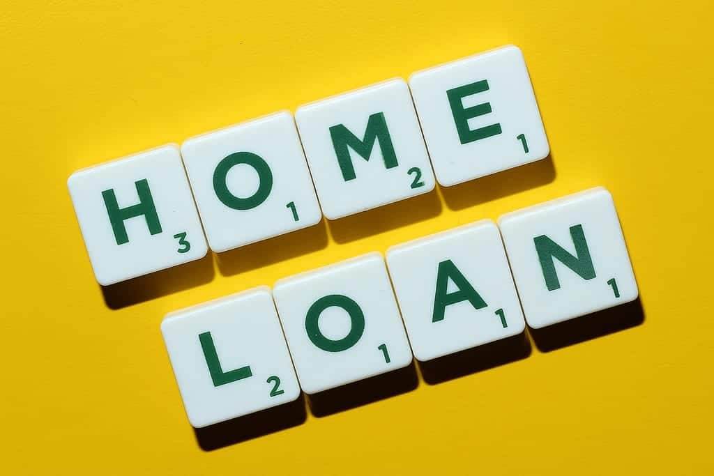 home loans spelled out with scrabble letters in dark green on ivory coloured tokens laying on a mustard yellow background