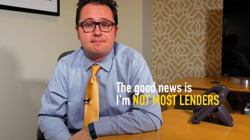 man in grey shirt, gold tie with glasses sitting at a table with message the good news is I'm not most lenders superimposed on the photo