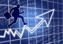 silhouette of a mortgage broker in suit with briefcase trying to run up an electronic graph arrow