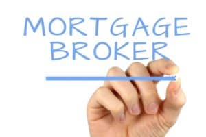 mortgage broker written in light blue on reverse glass by a mans hand