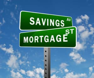 white and green street sign with savings pointing in one direction and mortgage in the other