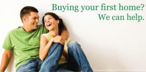 first home buyer loan- Happy laughing young couple sitting on the floor of their new home