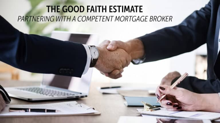 Mortgage broker shaking the hands of a couple across a table