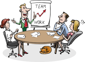 4 people around a business desk in front of a flip chart displaying the words team work