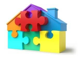 A toy house put together like a jig saw puzzle