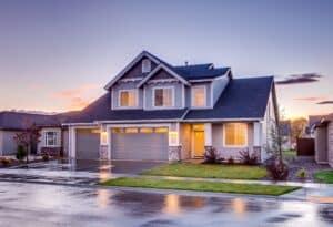 Blue grey coloured executive suburban home with attic at twilight