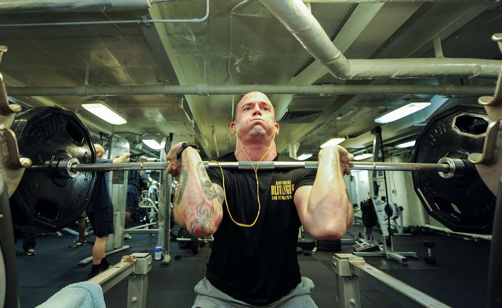 Weightlifting strongman squating with heavy weight
